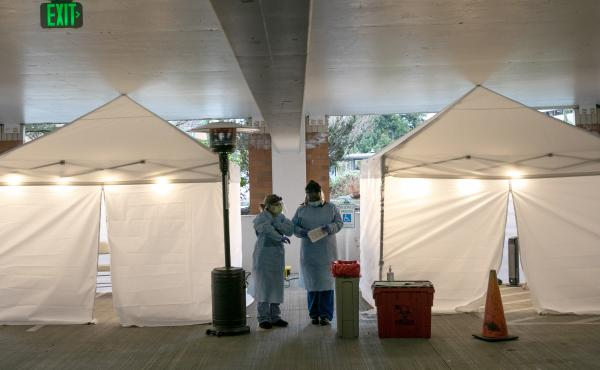 Nurses check registration lists before testing patients for coronavirus at the University of Washington Medical Center on March 13 in Seattle.