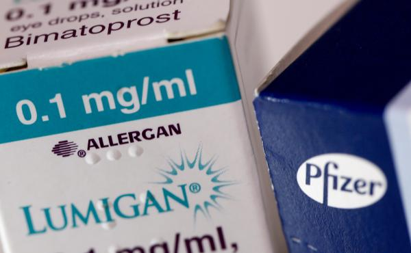 A box of Lumigan eye-drops, produced by Allergan Plc, stands next to a box of Viagra tablets, produced by Pfizer Inc. The Irish and American drugmakers were planning to merge, but the deal has been called off after a change in U.S. tax law reduced the pot