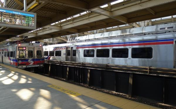 Two SEPTA Silverliner V trains, the newest railcars in the SEPTA fleet, wait in a Philadelphia train station in 2014. All Silverliner V cars have been pulled from service for repairs to significant structural problems.