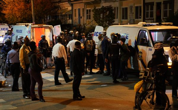 Philadelphia police issue a final warning for curfew violation to protesters at 55th and Pine Streets in West Philadelphia, on Wednesday, the third straight night of protesting and unrest after the fatal shooting of Walter Wallace Jr. by police.