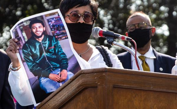 Tamika Morales holds a photo of her son, Ahmad, who was killed in South Philadelphia last July.