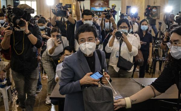 Maria Ressa, CEO of the Rappler news site, leaves a Philippine regional trial court after being convicted for cyber libel on June 15. Ressa, a veteran journalist and outspoken critic of President Rodrigo Duterte, is the focus of A Thousand Cuts, a documen