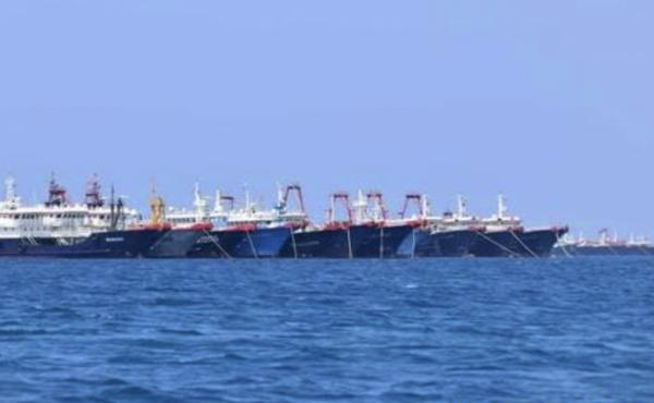 Some of the 220 Chinese vessels are seen moored in early March at the Whitsun Reef in the South China Sea.