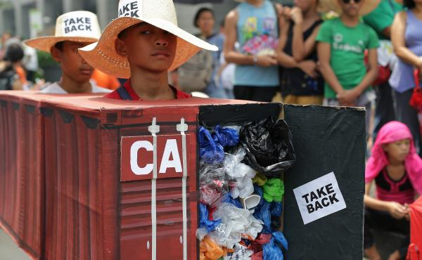 """""""I want a boat prepared"""" to take tons of trash back to Canada, Philippines President Rodrigo Duterte said Tuesday. In this 2015 photo, Filipino activists wear shipping container costumes to call on Canada to remove the garbage from a port in Manila."""