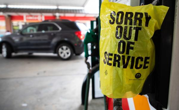 """A gas pump is marked """"out of service"""" as cars line up May 11 at a Circle K in Charlotte, N.C., following a ransomware attack that shut down Colonial Pipeline."""