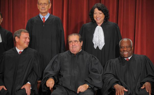 A plan to rename George Mason University's law school for late Supreme Court Justice Antonin Scalia (center) has been tweaked after the first name that was chosen sparked jokes on social media. Scalia is seen here with his fellow justices in 2009.