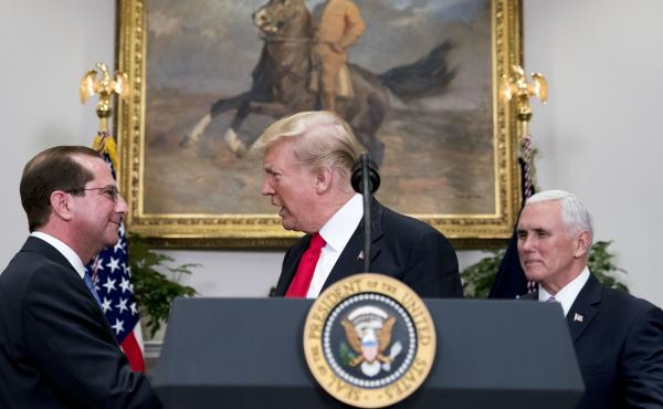 President Trump shakes hands with Health and Human Services Secretary Alex Azar  after he is sworn in by Vice President Pence on Jan. 29. Major reproductive health organizations are voicing concerns about the Trump administration's new approach to federal