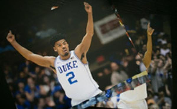 Quinn Cook, a guard for the Canton Charge, keeps photos of himself as a Duke University Blue Devil in his apartment in Canton. He was a member of Duke's 2015 men's national championship team.