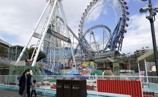 Japan's Tokyo Dome is shown before amusement rides began to reopen in the country. Japanese amusement park operators have asked people on rides at some parks not to scream.