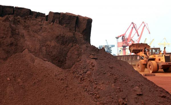A worker in China shifts soil containing rare earth minerals intended for export in 2010. Rare earths are used in important technologies, and a commentary in China's People's Daily newspaper on Wednesday said the U.S. endangers its supply from China by wa