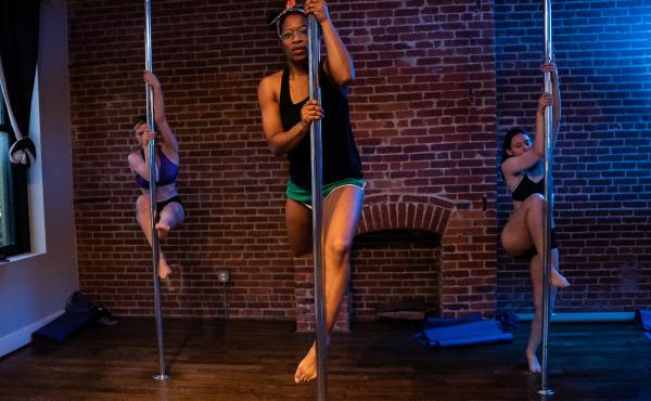 Students at Pole Pressure in Washington, D.C. combine strength, flexibility and creativity to learn routines in class.