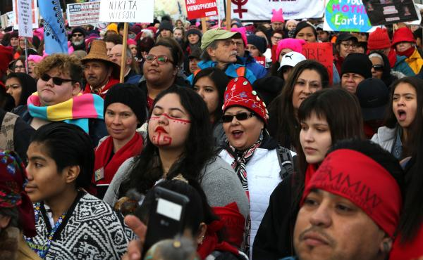 People listen to speakers raising awareness about missing and murdered Indigenous women at a rally at Cal Anderson Park in Seattle prior to the Women's March on January 20. A new report examines missing and murdered Indigenous women in cities, not on rese