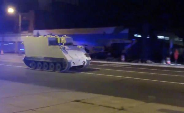 A stolen armored personnel carrier drives through Richmond, Va., on Tuesday.