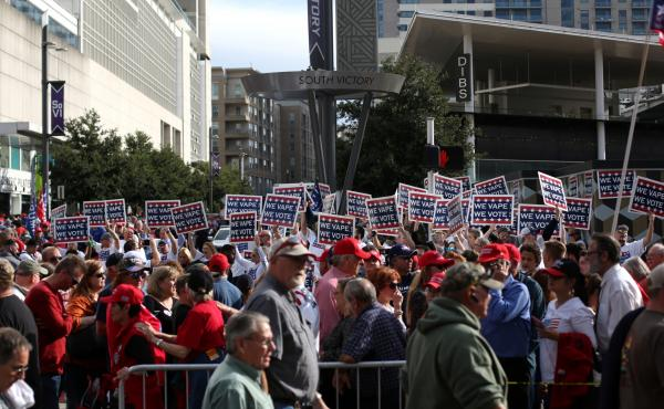 "Attendees hold ""We Vape, We Vote"" signs ahead of a Trump rally last month in Dallas. The politics surrounding vaping and industry pushback against regulation appear to have derailed the Trump administration's plan to ban the sales of many vaping products."