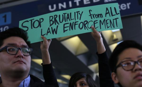 Demonstrators protest United Airlines at O'Hare International Airport on April 11, 2017 in Chicago, Illinois. The protest was in response to airport police officers physically removing passenger Dr. David Dao from his seat and dragging him off the airplan