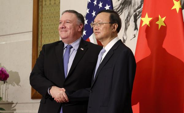 In this October 2018 photo U.S. Secretary of State Mike Pompeo (left) shakes hands with State Councilor Yang Jiechi, China's top diplomat, in Beijing. The two met Wednesday in Hawaii as relations between the U.S. and China continue to deteriorate.