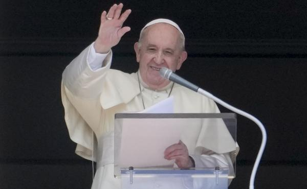 Pope Francis delivers his blessing as he recites the Angelus noon prayer from the window of his studio overlooking St.Peter's Square, at the Vatican, Sunday, Sept. 5, 2021.