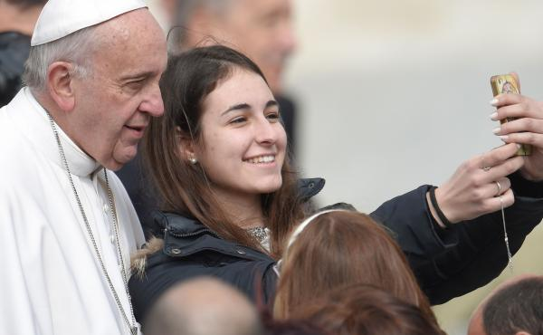 Pope Francis poses for a selfie with a young woman at the end of his weekly general audience at St Peter's square on Wednesday. The pope has now joined Instagram — although his account will be filled with press photos, not with selfies.