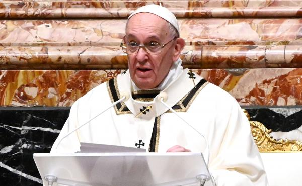Pope Francis is seen giving a homily on Christmas Eve. Francis on Sunday condemned the violence at the U.S. Capitol and prayed for reconciliation.