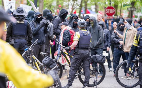 """In Portland, Ore., a May 1 rally and march began as a peaceful demonstration but later """"devolved into a full-scale riot,"""" police say."""