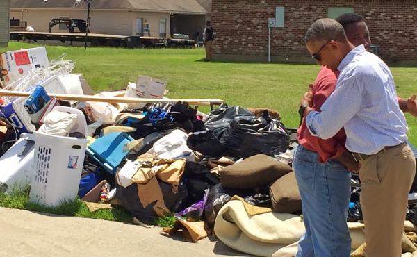 Obama tours a flood-damaged Baton Rouge neighborhood.
