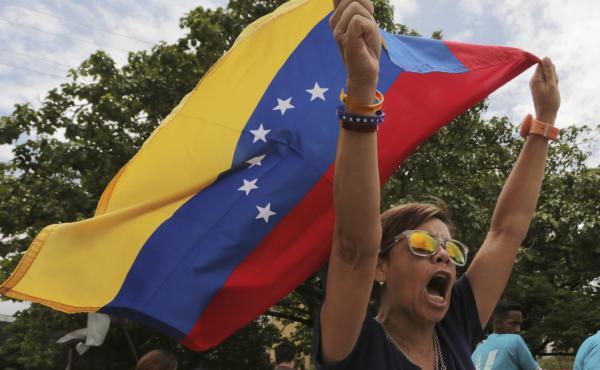 Opponents of Venezuelan President Nicolas Maduro protest the presidential election which Maduro won, in Caracas, Venezuela, on Monday.