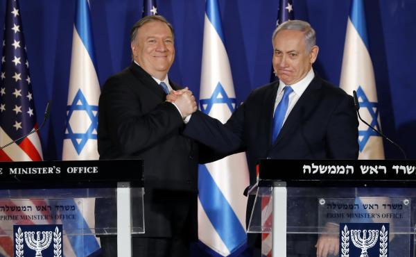 U.S. Secretary of State Mike Pompeo, left, shakes hands with Israeli Prime Minister Benjamin Netanyahu in Jerusalem Thursday.
