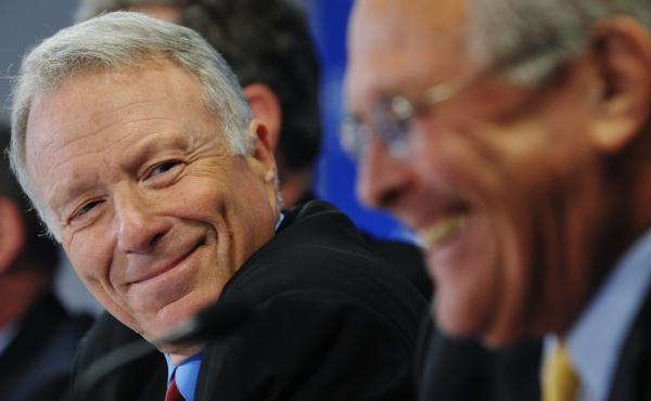 """Lewis """"Scooter"""" Libby, former chief of staff to Vice President Dick Cheney, shares a laugh with former Defense Secretary Donald Rumsfeld during a discussion at the conservative Hudson Institute."""