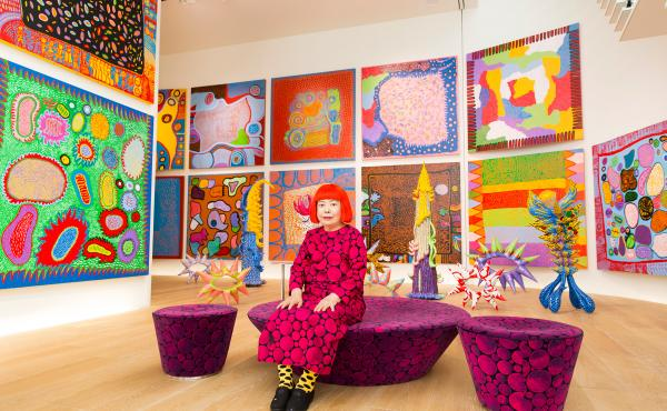 """Yayoi Kusama with recent works in Tokyo in 2016. In 1968, Kusama wrote, """"Our Earth is only one polka dot among a million stars in the cosmos. Polka dots are a way to infinity."""""""