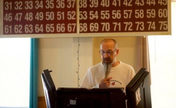 Louis Mithelavage casts his ballot at the Glen Lyon Italian American Sporting Club polling station during the Pennsylvania primary on Tuesday.