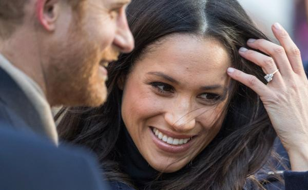 Prince Harry and fiancee Meghan Markle arrive at an AIDS Day charity event on Dec. 1. Their spring wedding plans have sparked controversy over the homeless in Windsor.