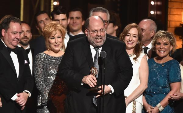 Producer Scott Rudin, center, and the cast of Hello, Dolly! accept the award for Best Revival of a Musical at the 2017 Tony Awards in New York City. Rudin says he's stepping back from his Broadway work.