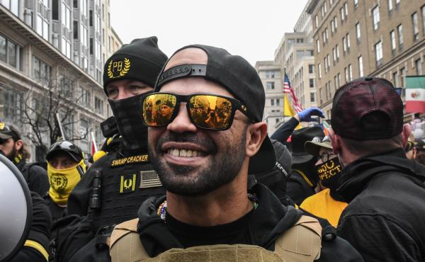 Enrique Tarrio, leader of the Proud Boys, during a protest last month in Washington, D.C. Tarrio has been charged with destruction of property and possession of high-capacity firearm magazines.