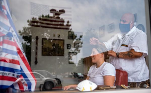 A woman gets a haircut on Friday in Round Rock, Texas, as the state slowly reopens from its pandemic shutdown.