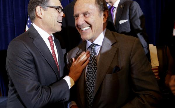 In a photo from 2015, then-Republican presidential candidate, former Texas Gov. Rick Perry, greets New York Daily News publisher Mortimer Zuckerman during a luncheon hosted by the Committee to Unleash Prosperity, at the the Yale Club in New York.