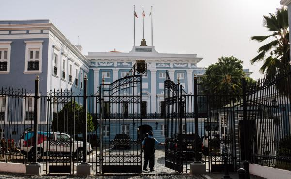 A security guard stands at the gate of the Governor's Mansion, known as the La Fortaleza, in San Juan, Puerto Rico.