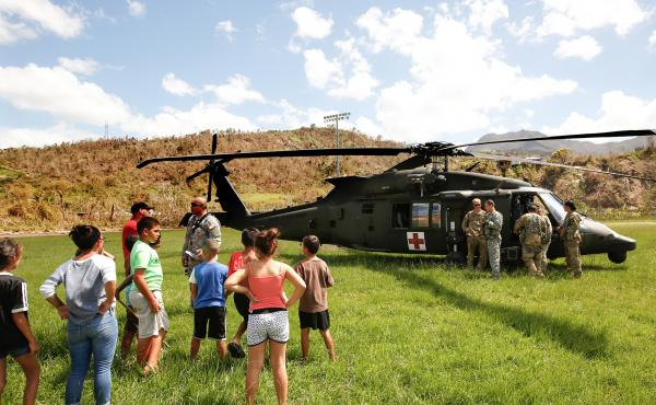 In the mountain town of Juyaya, Puerto Rico, last October, children watched as U.S. Army helicopters brought a team of physicians to assess the medical needs of the local hospital and residents. Going forward, health economists say, the U.S. territory wil
