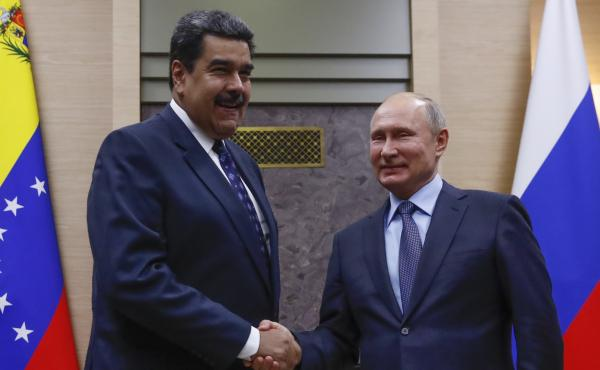 Russian President Vladimir Putin shakes hands with Venezuela's Nicolás Maduro during a meeting outside Moscow on Dec. 5.