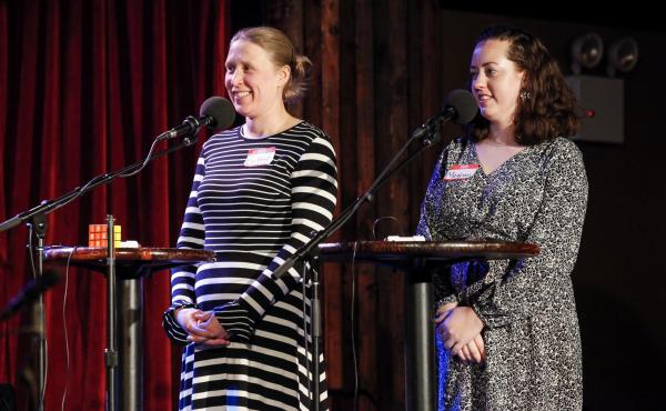 Contestants Britter Gunderson and Meghan Ballback compete in the Ask Me Another final round at The Bell House in Brooklyn, New York.