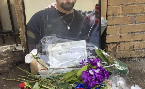 A memorial for John Elifritz, a carjacking suspect who was shot and killed by police, stands on a sidewalk in front of a Portland, Ore., homeless shelter on Monday. Groups and family members are raising questions about whether officers resorted to deadly