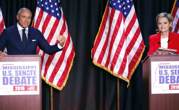 Democrat Mike Espy and Republican Sen. Cindy Hyde-Smith participate in a televised Senate debate Tuesday night in Jackson, Miss.
