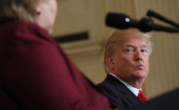 President Trump listens as Norwegian Prime Minister Erna Solberg speaks at a joint news conference Wednesday. At an Oval Office meeting on immigration policy, Trump said the U.S. should want more people from countries like Norway, disparaging Haiti and wh