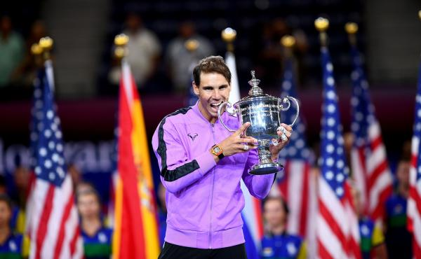 Rafael Nadal brandishes the spoils of his U.S. Open final victory over Russian Daniil Medvedev on Sunday. The Spaniard's win in New York City — his fourth U.S. Open title — gives him 19 career individual grand slam wins, just one shy of rival Roger Fe