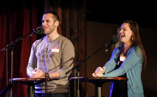 Contestants Jake Douglas and Megan Osimanti compete in a game on Ask Me Another at the Bell House in Brooklyn, New York.
