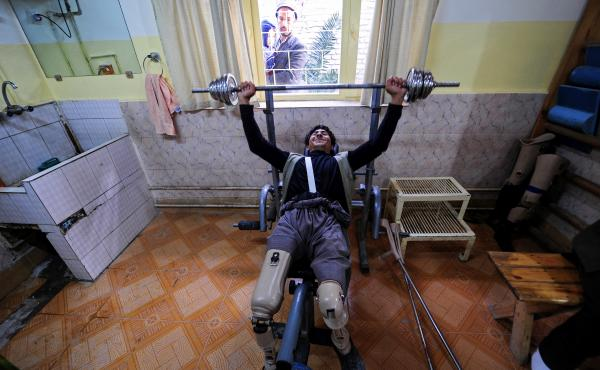 An Afghan amputee lifts weights at the International Committee of the Red Cross facility for war victims and the disabled in Mazar-i-Sharif. In September, a patient shot and killed a staffer, closing the center for a month and contributing to a decision t