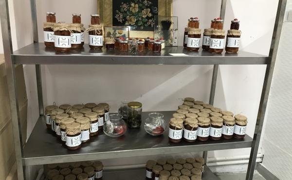 """Some of the jams and preserves made by the """"Women's Solidarity Kitchen"""" in Istanbul, on display in their commercial kitchen."""
