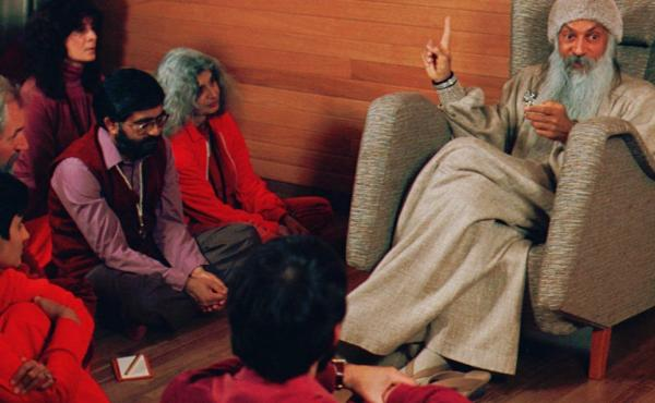 Bhagwan Shree Rajneesh, right, speaks with his disciples in this undated photo in Rajneeshpuram, Ore.