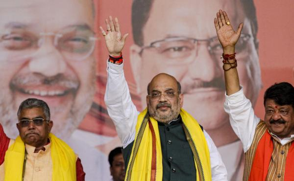 India Home Minister Amit Shah (center) introduced India's new citizenship law that fast-tracks naturalization for some non-Muslim migrants. Opponents say it violates India's secular constitution.