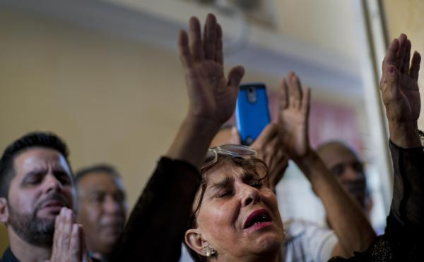 Evangelicals pray during a church service in Havana, Cuba. Religious groups on the island have come out in opposition to a new constitution which will be voted on on Sunday.