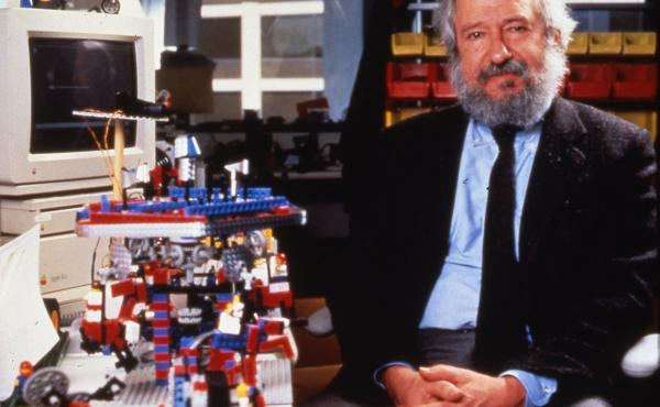 Seymour Papert with LEGO Mindstorms robotics kits, which were named in recognition of Papert's seminal book, Mindstorms: Children, Computers, and Powerful Ideas.